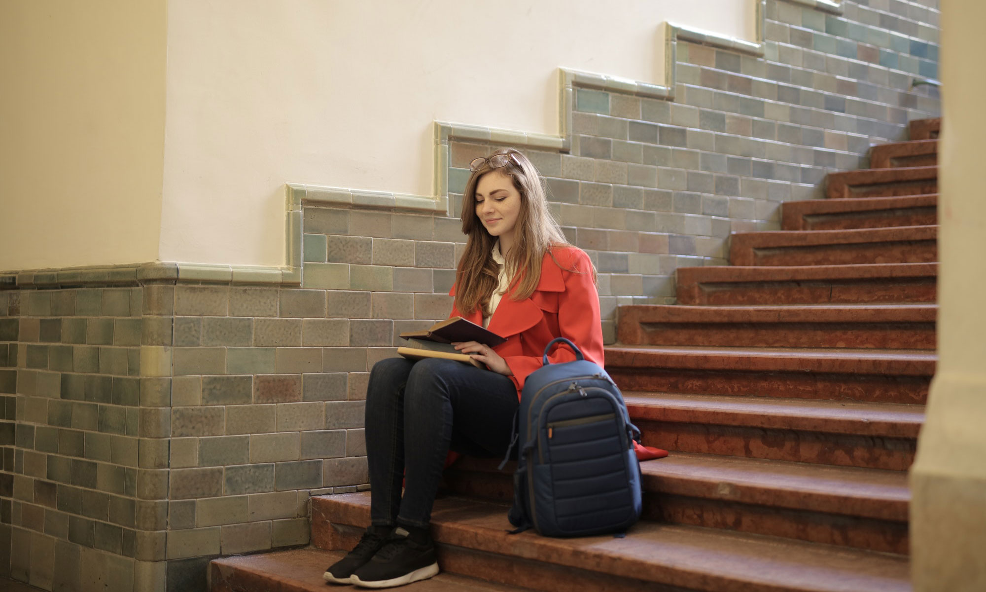 girl reading on steps